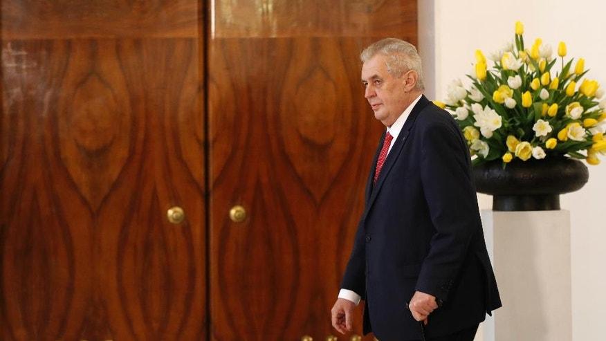 Czech Republic's President Milos Zeman arrives to deliver a statement for media in Prague, Czech Republic, Friday, March 10, 2017. U.S. President Donald Trump's European ally Milos Zeman said he wants to seek re-election in next year's Czech presidential election. (AP Photo/Petr David Josek)