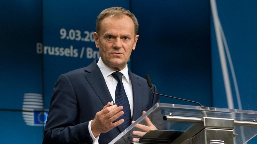 European Council President Donald Tusk speaks during a media conference at an EU summit in Brussels on Thursday, March 9, 2017. European Union leaders confirmed Donald Tusk for a second term as council president Thursday, overcoming weeks of strong opposition from his native Poland. (AP Photo/Virginia Mayo)