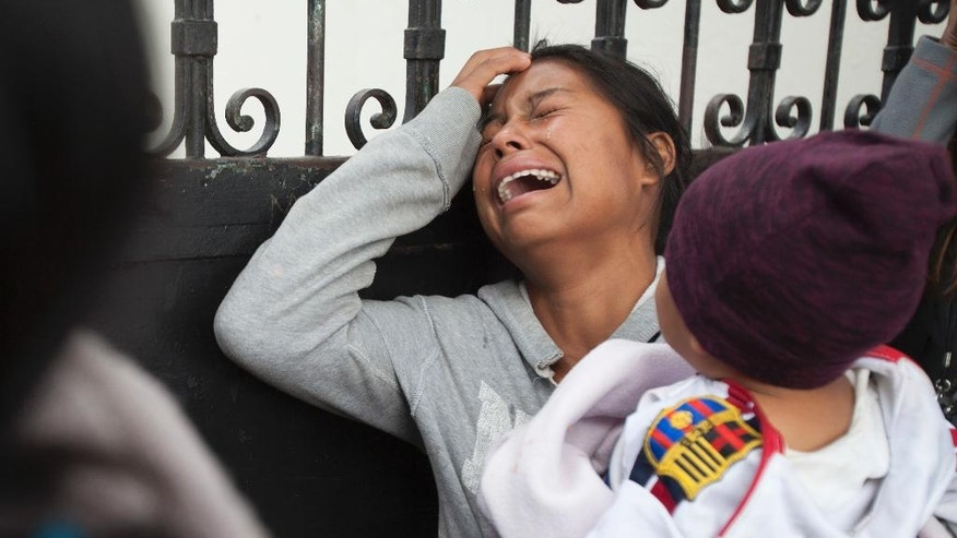 A relative of a youth who resided at the Virgin of the Assumption Safe Home wails as she waits for the release of the names of those who died in a fire at the shelter, outside the morgue where the bodies are being identified in Guatemala City, Thursday, March 9, 2017. The death toll in the fire at a the youth shelter on the outskirts of Guatemala rose to 31 Thursday as a dozen more girls died at hospitals overnight and details began to emerge of a tragedy fueled by angry, neglected youths seeking to flee terrible conditions. (AP Photo/Moises Castillo)