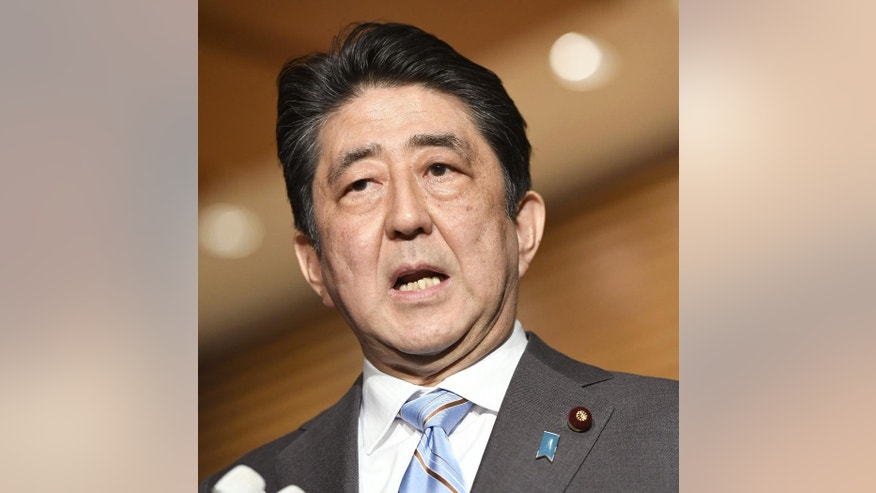 Japanese Prime Minister Shinzo Abe speaks to the media at the Prime Minister's official residence in Tokyo Friday, March 10, 2017. Abe says Japan is ending its peacekeeping mission in South Sudan after 5 years, with work finished. (Junko Ozaki/Kyodo News via AP)