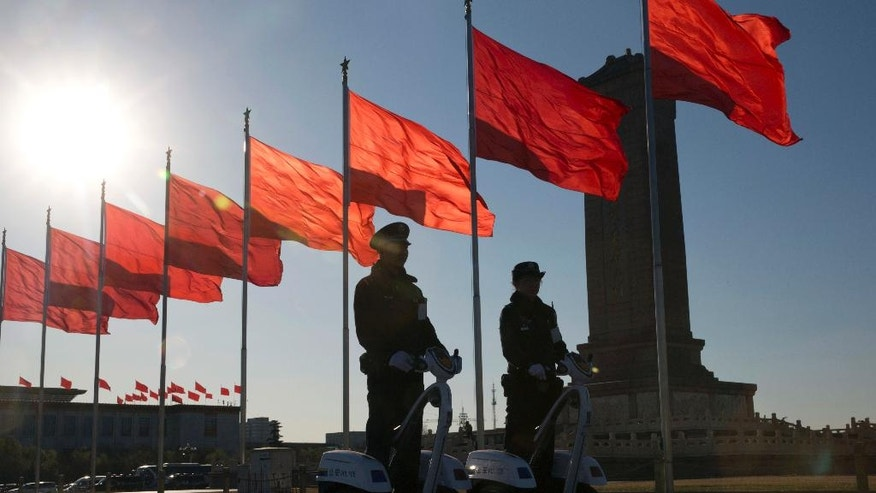 "Chinese police officers patrol on motorized platforms on Tiananmen Square near the Great Hall of the People where a plenary session of the National People's Congress is held in Beijing, China, Sunday, March 12, 2017. China's chief justice Zhou Qiang said Sunday during his work report to the Congress that his country, which is believed to execute more people than the rest of the world combined, gave the death penalty ""to an extremely small number of criminals for extremely serious offenses"" in the past 10 years. (AP Photo/Ng Han Guan)"