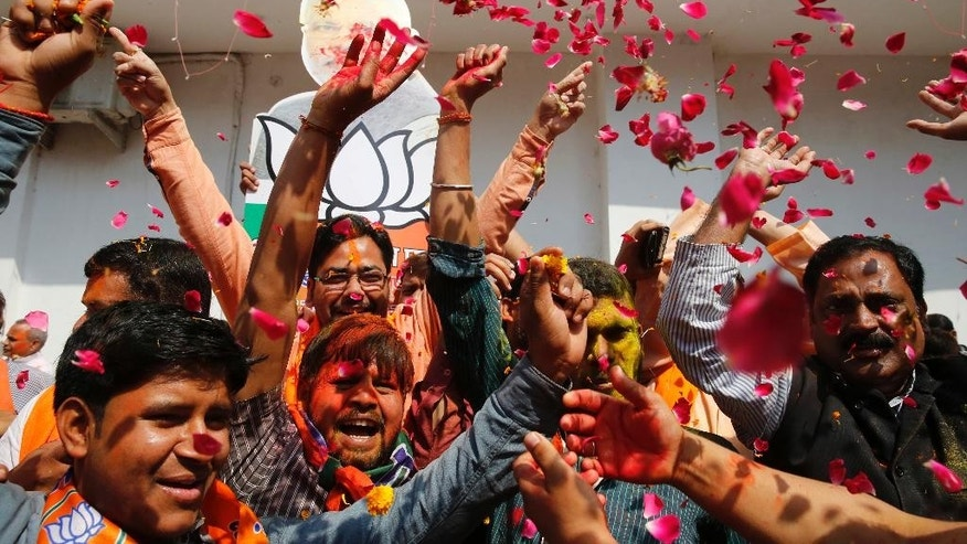 Bharatiya Janata Party supporters celebrate winning seats in the state legislature during elections in Utar Pradesh, Lucknow, India, Saturday, March 11, 2017. India's governing Hindu nationalist party is heading for major victories in key state legislature elections that are seen as a referendum on Prime Minister Narendra Modi's nearly 3-year-old rule. (AP Photo/Rajesh Kumar Singh)