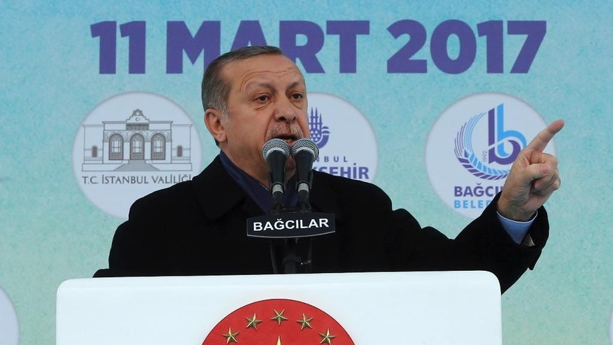 Turkey's President Recep Tayyip Erdogan addresses his supporters in Istanbul, Saturday, March 11, 2017. The Dutch government on Saturday withdrew landing permission for the Turkish Foreign Minister Mevlut Cavusoglu's aircraft, drawing the ire of the Turkish president and escalating a diplomatic dispute between the two NATO allies over campaigning for a Turkish referendum on constitutional reform. Turkish President Recep Tayyip Erdogan promised retaliation against Dutch diplomatic flights.(Pool Photo via AP)