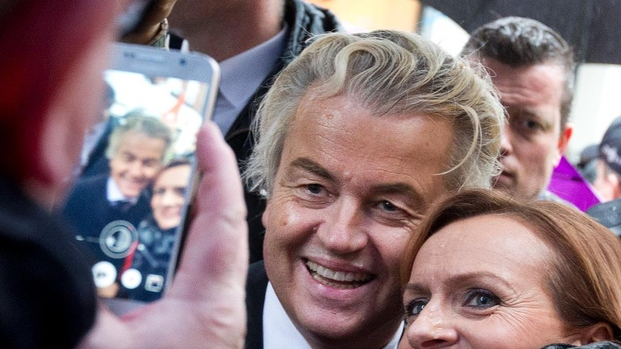 Firebrand anti-Islam lawmaker Geert Wilders poses for a picture during a campaign stop in Breda, Netherlands, Wednesday, March 8, 2017. (AP Photo/Peter Dejong)