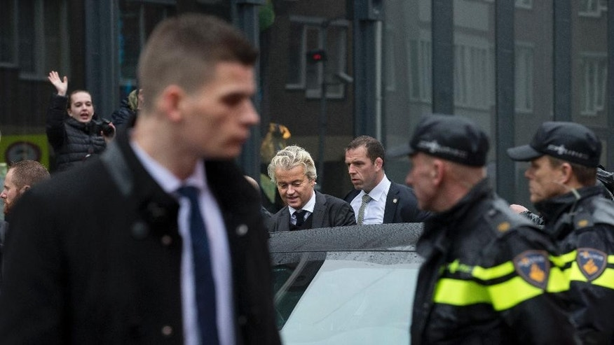 Firebrand anti-Islam lawmaker Geert Wilders gets into his car after a campaign stop in Breda, Netherlands, Wednesday, March 8, 2017. (AP Photo/Peter Dejong)