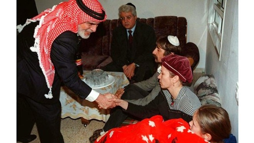 King Hussein of Jordan in 1997 shakes the hand of members of the Badayev family in Beit Shemesh who are in mourning after their daughter Shiri was killed by a Jordanian soldier.