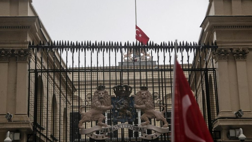 "A Turkish flag is lowered on the Dutch consulate in Istanbul shortly after a man climbed onto the roof and replaced the Netherlands' flag with the Turkish one, Sunday, March 12, 2017. The escalating dispute between Turkey and the Netherlands spilled over into Sunday, with a Turkish minister unable to enter her consulate after the authorities there had already blocked a visit by the foreign minister, prompting Turkish President Recep Tayyip Erdogan to call the Dutch "" fascists."" (AP Photo)"