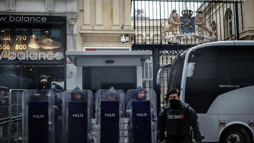 "Riot police stand guard outside the Dutch consulate in Istanbul, Sunday, March 12, 2017. The escalating dispute between Turkey and the Netherlands spilled over into Sunday, with a Turkish minister unable to enter her consulate after the authorities there had already blocked a visit by the foreign minister, prompting Turkish President Recep Tayyip Erdogan to call the Dutch "" fascists."" (AP Photo/ Emrah Gurel)"