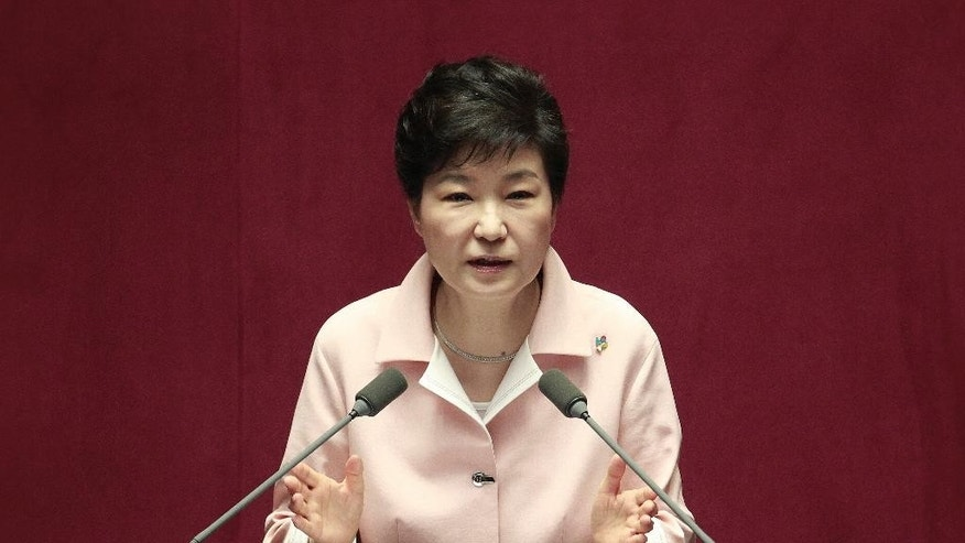 FILE - In this June 13, 2016, file photo, South Korean President Park Geun-hye delivers a speech during the opening ceremony of the 20th National Assembly at the National Assembly in Seoul, South Korea. Hundreds of police officers, reporters and supporters of the ousted president have gathered near her Seoul home in anticipation of her return from the presidential palace. An official from the presidential Blue House said Sunday, March 12, 2017, that there was a possibility that Park would leave during the evening, two days after the country's Constitutional Court removed her from office over a corruption scandal. (AP Photo/Ahn Young-joon, File)