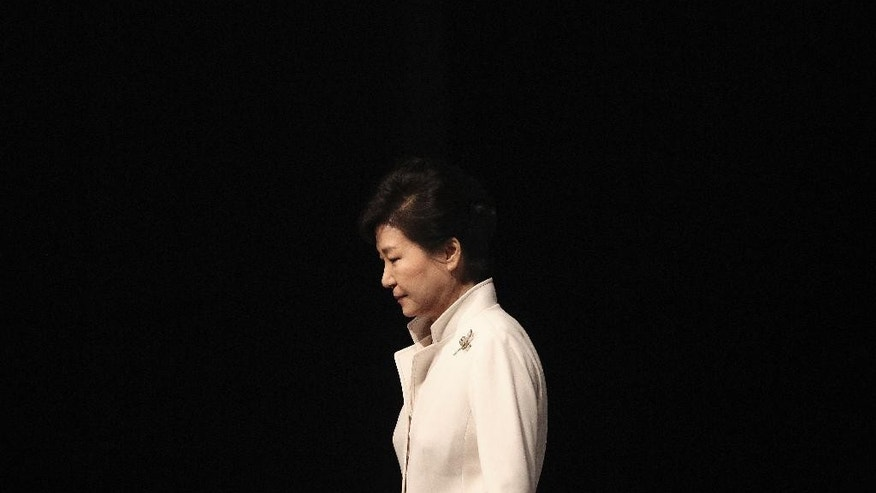 FILE - In this March 1, 2016, file photo, South Korean President Park Geun-hye leaves after a ceremony to celebrate the March First Independence Movement Day, the anniversary of the 1919 uprising against Japanese colonial rule, in Seoul, South Korea. Hundreds of police officers, reporters and supporters of the ousted president have gathered near her Seoul home in anticipation of her return from the presidential palace. An official from the presidential Blue House said Sunday, March 12, 2017, that there was a possibility that Park would leave during the evening, two days after the country's Constitutional Court removed her from office over a corruption scandal. (AP Photo/Ahn Young-joon, File)