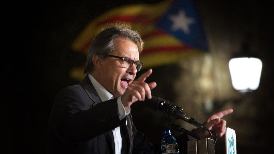 FILE - In this Sept. 23, 2015 file photo, the then President of the Democratic Convergence of Catalonia, Artur Mas, talks during a rally in Barcelona, Spain. Former Catalonia regional government chief Artur Mas faces a 2 year ban from holding public office for ignoring a Constitutional ban and organizing a vote on the region's independence from Spain, a court in Barcelona ruled Monday March 13, 2017. (AP Photo/Emilio Morenatti, File)