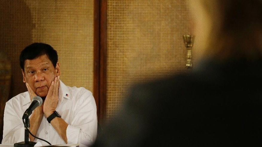 Philippine President Rodrigo Duterte listens as a reporter asks a question during a press conference at the Malacanang presidential palace in Manila, Philippines on Monday, March 13, 2017. The Philippine president has ordered the military to assert his country's ownership of a vast offshore region off its northeastern coast where Chinese survey ships have been sighted last year and alarmed defense officials. (AP Photo/Aaron Favila)