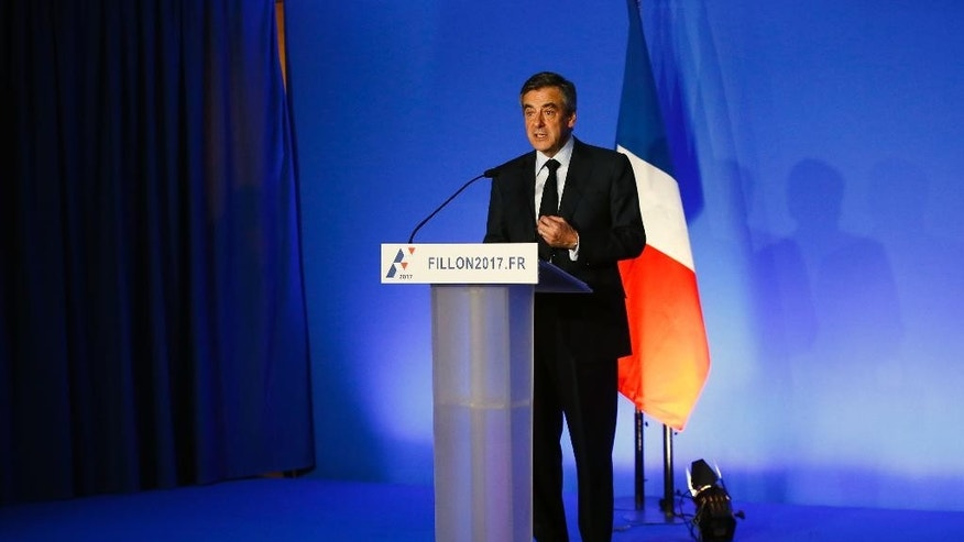French conservative presidential candidate Francois Fillon presents his program in Paris, Monday, March 13, 2017. Once the front-runner in the race for the April 23-May 7 election, Fillon is presenting a new version of his campaign platform Monday in an effort to claw back support. (AP Photo/Francois Mori)