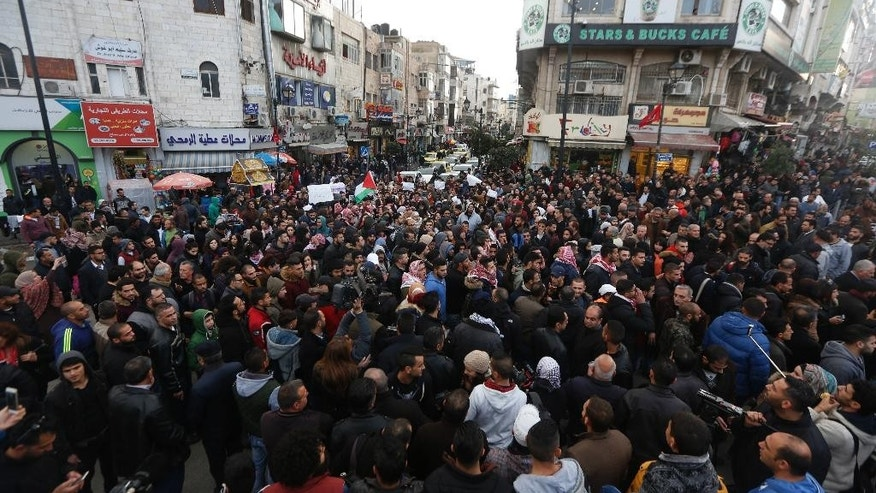 Palestinians gather in an anti -government demonstration calling for the president Mahmoud Abbas to resign and an end to security cooperation with Israel in the West Bank city of Ramallah, Monday, March 13, 2017. (AP Photo/Majdi Mohammed)