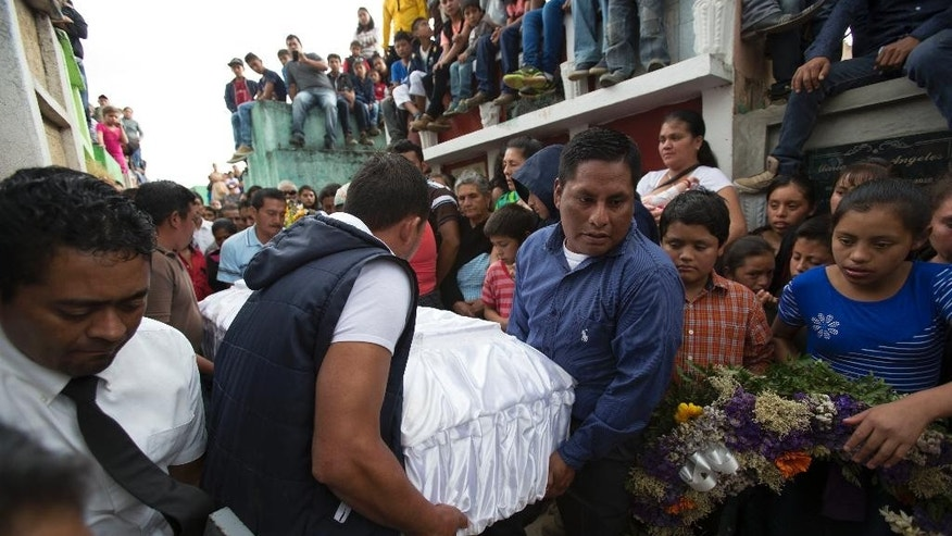People carry the coffin of 14-year-old Ana Roselia Perez Junay, who died in a fire at a children's shelter, at the cemetery in Zaragoza, Guatemala, Sunday, March 12, 2017. The death toll in the March 8 fire rose to 40 on Sunday with the announcement that another girl has died of burns. (AP Photo/Moises Castillo)