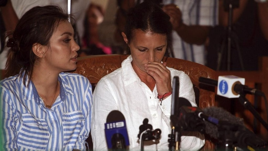 Australian national Sara Connor, right, reacts during her verdict trial in Bali, Indonesia, Monday, March 13, 2017. Indonesian judges sentences Connor for four years and British man David Taylor for six years in prison for the murder of an Indonesian police officer in August, 2016. (AP Photo/Firdia Lisnawati)