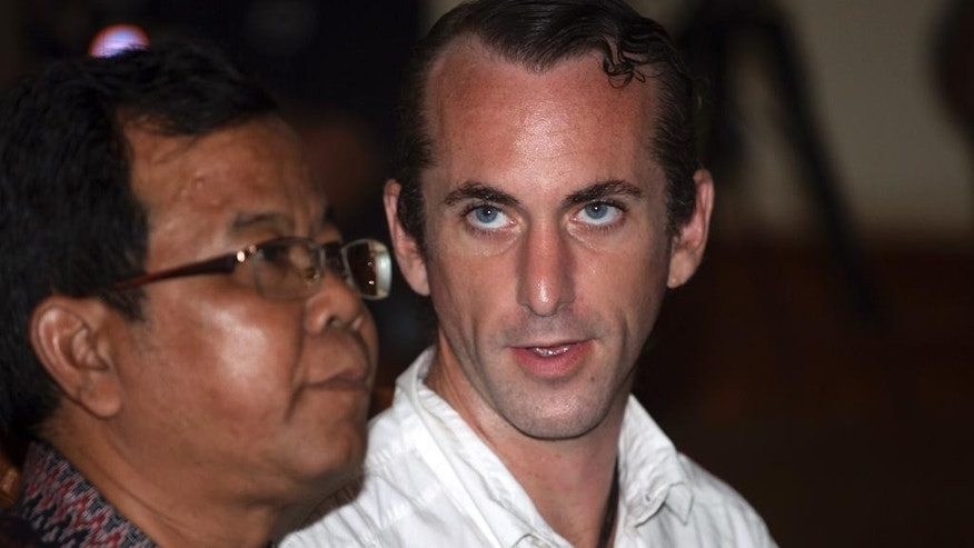 British national David Taylor, right, talks to his interpreter during his verdict trial in Bali, Indonesia, Monday, March 13, 2017. Indonesian judges sentenced Taylor for six years and his Australian girlfriend Sara Connor for four years in prison for the murder of an Indonesian police officer in August, 2016. (AP Photo/Firdia Lisnawati)