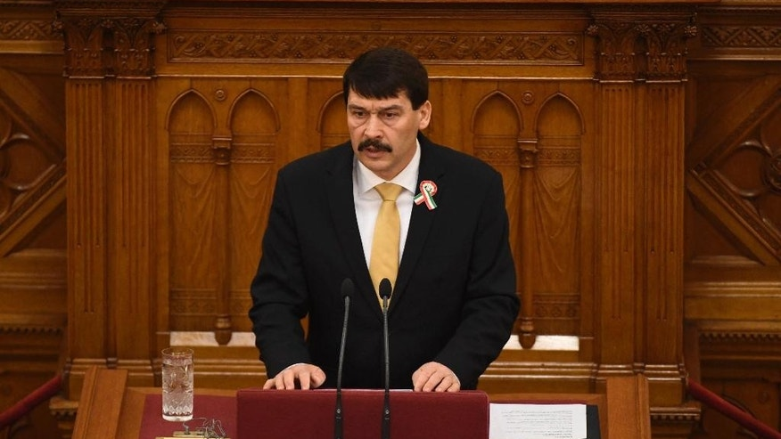 Hungarian President Janos Ader delivers his speech during the plenary session of the unicameral Hungarian Parliament in Budapest, Hungary, Monday, March 13, 2017, when the deputies elect the President of Hungary for the next term of five years. Janos Ader is up against the candidate of the opposition coalition Laszlo Majtenyi for the post. (Szilard Koszticsak/MTI via AP)
