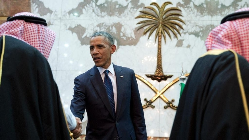 FILE- In this Jan. 27, 2015 file photo, President Barack Obama participates in a receiving line with the Saudi Arabian King, Salman bin Abdul Aziz, at Erga Palace in Riyadh, Saudi Arabia. When President Donald Trump meets with Saudi Arabia's Deputy Crown Prince Mohammed bin Salman at the White House in the coming days, the new commander-in-chief will be laying the groundwork for his administration's relations with a Middle Eastern powerhouse and the world's top oil exporter. (AP Photo/Carolyn Kaster, File)