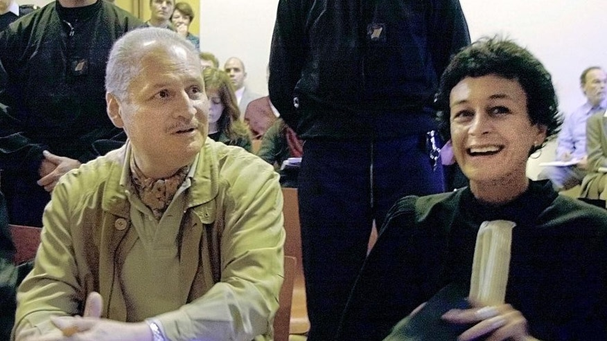 FILE - In this Tuesday, Nov. 28, 2000 file photo, Venezuelan international terrorist Carlos the Jackal whose real name is Ilich Ramirez Sanchez, left, sits with his French lawyer Isabelle Coutant-Peyre in a Paris courtroom. Ilich Ramirez Sanchez, also known as Carlos the Jackal, is due to go on trial Monday for a deadly attack in a Paris' popular shopping mall decades ago, the oldest one blamed on the former public enemy in France and probably the last one to come to court. (AP Photo/Michel Lipchitz, File)