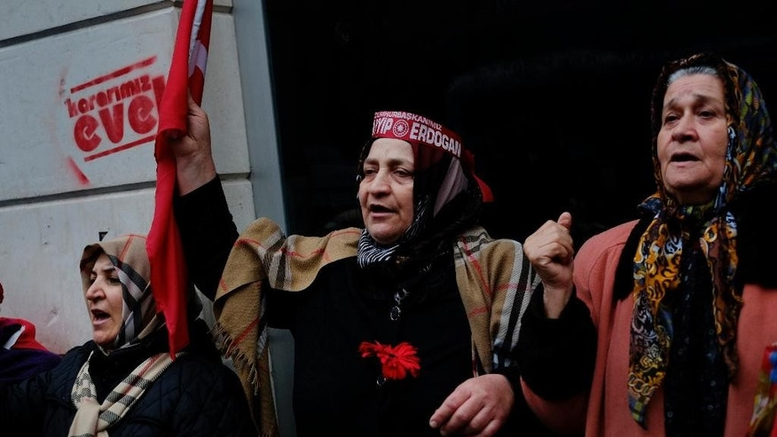 "Turkish women chant slogans during a protest outside the Dutch consulate in Istanbul, Sunday, March 12, 2017. Turkish President Recep Tayyip Erdogan says he appropriately accused the Dutch government of ""Nazism and fascism,"" saying only those types of regimes would bar foreign ministers from traveling within their countries. (AP Photo/Lefteris Pitarakis)"