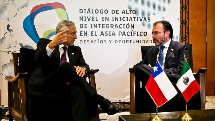 Chile's Foreign Affairs Minister Heraldo Munoz, left, talks with Mexico's Foreign Relations Secretary Luis Videgaray prior a meeting with representatives from the Trans-Pacific Partnership in Vina del Mar, Chile, Tuesday,March 14, 2017. Senior officials from the 12 countries of the TPP, plus China and South Korea, begin meeting at the seaside resort city for the first time since U.S. President Donald Trump withdrew from the deal. (AP Photo/Esteban Felix)