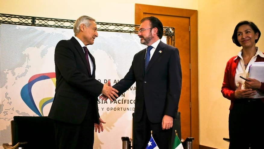 Chile's Foreign Affairs Minister Heraldo Munoz, left, shake hands with Mexico's Foreign Relations Secretary Luis Videgaray prior a meeting with representatives from the Trans-Pacific Partnership in Vina del Mar, Chile, Tuesday,March 14, 2017. Senior officials from the 12 countries of the TPP, plus China and South Korea, begin meeting at the seaside resort city for the first time since U.S. President Donald Trump withdrew from the deal. (AP Photo/Esteban Felix)