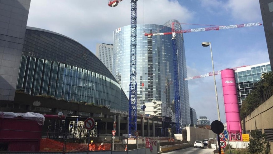 Cranes are pictured at La Defense business district, Monday, March 13, 2017 just outside Paris. At the La Defense financial center in Paris, construction plans are advanced for seven more skyscrapers by 2021. Its boosters already have placed subway ads in the City of London suggesting that Paris might offer a nicer personal environment. (AP Photo/Jeffrey Schaeffer)