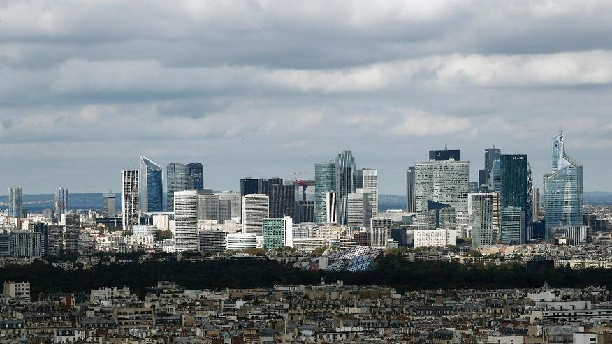 This photo taken on Wednesday, Sept. 28, 2016 shows the business district of La Defense, just outside Paris. At the La Defense financial center, construction plans are advanced for seven more skyscrapers by 2021. Its boosters already have placed subway ads in the City of London suggesting that Paris might offer a nicer personal environment. (AP Photo/Christophe Ena)