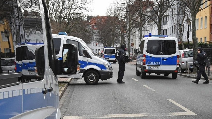 German police block a street  outside the  Islamic Society of Hildesheim (DIK) mosque, after a raid in Hildesheim, Germany, Tuesday, March 14, 2017.  ( Holger Hollemann/dpa via AP)