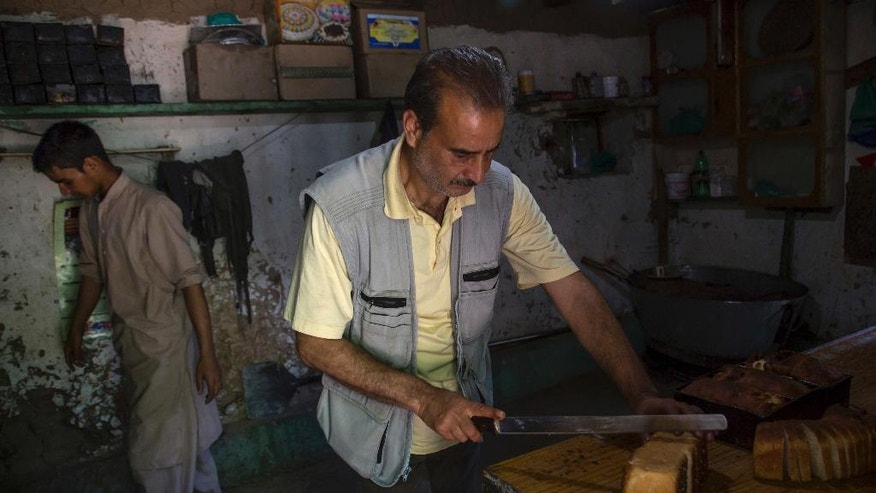 In this June 2, 2016, photo, Qazi Barat, a former Kashmiri militant works inside his bakery in Delina, 50 kilometers (31 miles) north of Srinagar, Indian controlled Kashmir. Hundreds of former Kashmiri militants who gave up their anti-India rebellion to return home are stuck in legal limbo, refused citizenship documents, jobs and admission for their children to schools. (AP Photo/Dar Yasin)