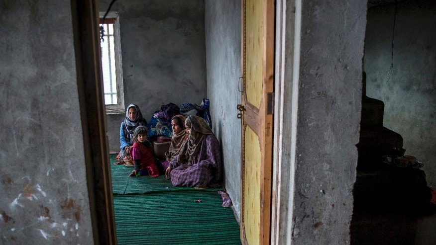 "In this March 9, 2017, photo, Pakistan-Kashmiri Safeena Bashir, second right, wife of former Kashmiri militant Syed Bashir Bukhari who committed suicide, sits along with her daughters Saba, right and Beenish, and her granddaughter Mehak at her residence in Kreeri, 35 kilometers (22 miles) north of Srinagar, Indian controlled Kashmir. ""We were cheated,"" Safeena said about the family's decision to accept an Indian deal promising citizenship and reintegration in exchange for giving up the fight against Indian rule. The family is part of the latest generation caught up in a violent conflict that has dominated Kashmiri life since 1947, when India and Pakistan gained independence from the British Empire and almost immediately began fighting over rival claims to this mountain territory. (AP Photo/Dar Yasin)"