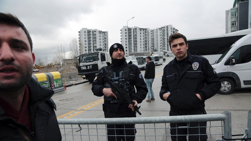 "Turkish security officers stand at a barricade outside the Dutch embassy in Ankara, Turkey, Monday, March 13, 2017. Tensions between Turkey and Western Europe simmered Monday, with Turkey's foreign ministry formally protesting the treatment of a Turkish minister who was escorted out of the Netherlands over the weekend and what Turkey called a ""disproportionate"" use of force against demonstrators at a protest afterward. (AP Photo/Burhan Ozbilici)"