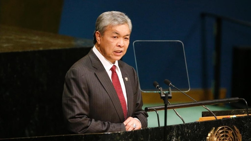 FILE - In this Sept. 24, 2016 file photo, Malaysia's Deputy Prime Minister Ahmad Zahid Hamidi addresses the 71st session of the United Nations General Assembly at U.N. headquarters. Zahid said Tuesday, March 14, 2017,  that the body of Kim Jong Nam, who was killed in February, has been embalmed to better preserve it, and that about 50 North Koreans whose work permits have expired will be deported.  News of the deportations was a surprise as the countries have barred each other's citizen from leaving amid a diplomatic standoff over Kim's death. (AP Photo/Jason DeCrow, File)
