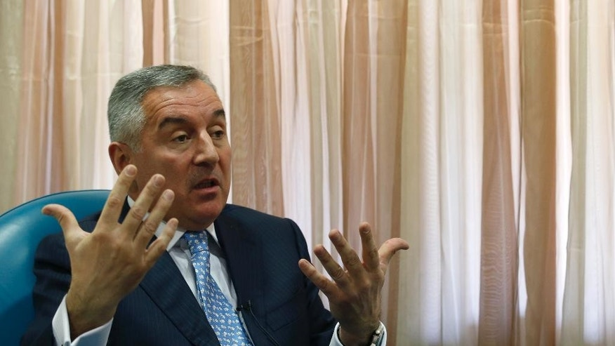 "Montenegro's former Prime Minister Milo Djukanovic speaks during an interview with The Associated Press, in Podgorica, Montenegro, Tuesday, March 14, 2017. Djikanovic has called on the European Union to stop Russia's ""destructive"" influence in the Balkans following what the country says was a thwarted attempt to overthrow its pro-Western government. (AP Photo/Darko Vojinovic)"