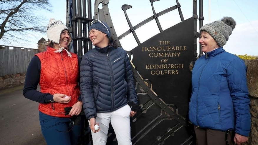 Holidaymakers Anna Dietrich, Pascale Reinhard and Jeanette Siehenthiler, from left, smile after playing a round of golf following the announcement that women will be admitted as members of Muirfield Golf Club after a membership ballot was held by The Honourable Company of Edinburgh Golfers, in Gullane, Scotland Tuesday, March 14, 2017. Muirfield Golf Club voted Tuesday to admit female members for the first time in its 273-year history, paving the way for the Scottish golf club to again host the British Open.  ( Jane Barlow/PA via AP)