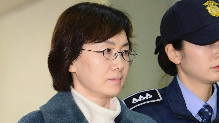 In this Feb. 26. 2017, photo, former Ewha Womans University President Choi Kyung-hee arrives at the office of the independent counsel in Seoul, South Korea. When the Constitutional Court removed President Park Geun-hye from office last week, there were waves of social media messages thanking students at one South Korean university for sparking the historic change. Last summer, Ewha Womans University students gathered to protest something that initially seemed unrelated to national politics, but the sit-in ended up sparking the popular movement that would help unseat Park. (Kwon Hyun-goo/Newsis via AP) KOREA OUT