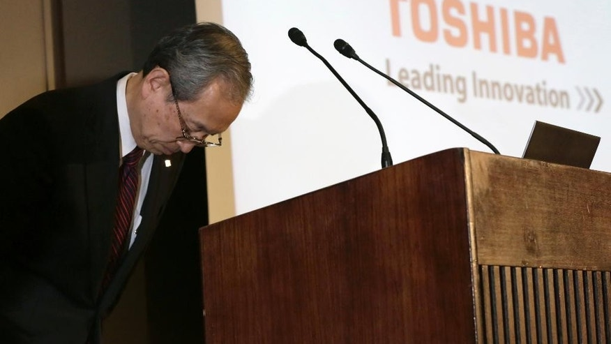 Toshiba Corp. President Satoshi Tsunakawa bows at the press conference at the company's headquarters in Tokyo, Tuesday, March 14, 2017. Troubled Japanese nuclear and electronics company Toshiba said Tuesday it was considering selling its money-losing Westinghouse operations in the U.S. (AP Photo/Eugene Hoshiko)