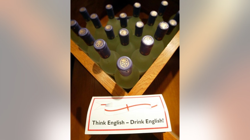 FILE- In this Wednesday, April 21, 2004 file photo, wine for sale in the shop at Denbies Wine Estate in Dorking on the outskirts of London. A lawmaker says, Tuesday, March 14, 2017, diplomats should boost the U.K. economy after Brexit by ditching champagne, cava and prosecco in favor of British bubbly at embassy receptions. (AP Photo/Dave Caulkin, File)