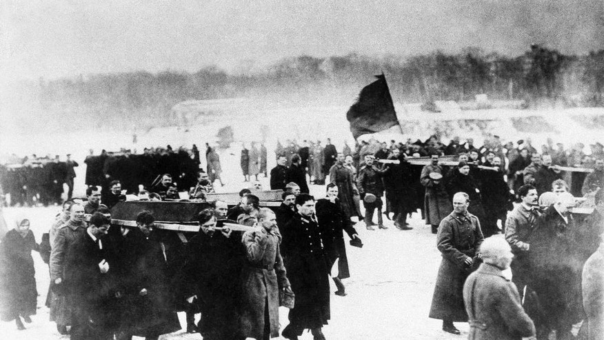 FILE  - In this 1917 file photo, a scene of the Russian Revolution. The tumult that Russia endured in 1917 sent shockwaves around the world as its last czar, Nicholas II, abdicated his throne, and power was later seized by Vladimir Lenin's Bolsheviks. A century later, the anniversary is being marked with little official commemoration from the Kremlin. (AP Photo, File)