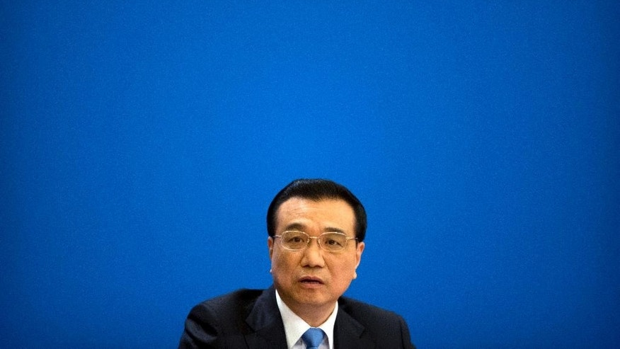 Chinese Premier Li Keqiang listens to a reporter's question during a press conference held at the conclusion of the annual meeting of China's National People's Congress (NPC) at the Great Hall of the People in Beijing, Wednesday, March 15, 2017.  China's No. 2 leader said Wednesday his government hopes for positive relations with Washington and has no desire for a trade war nor plans to devalue its currency to boost exports.(AP Photo/Mark Schiefelbein)