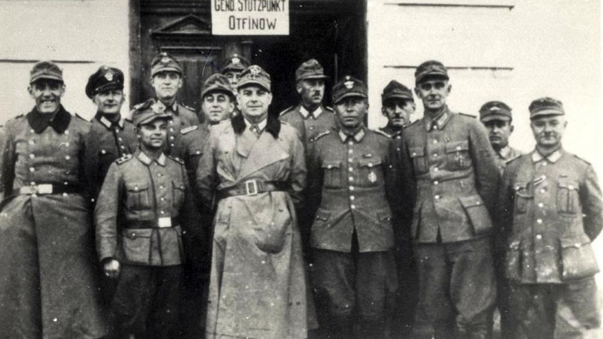 This undated World War II photo released by the Yad Vashem Holocaust memorial shows a group of Polish gendarmes. A prominent Polish historian presented new evidence Wednesday, March 14, 2017, about Polish villagers' widespread killing of Jews fleeing Nazis during World War II, touching a raw nerve in a country still grappling with its role during the Holocaust. (Yad Vashem via AP)
