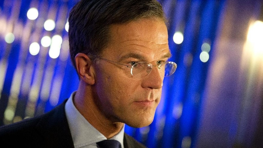 Dutch Prime Minister Mark Rutte answers questions after the closing debate at parliament in The Hague, Netherlands, Tuesday, March 14, 2017. Amid unprecedented international attention, the Dutch go to the polls Wednesday in a parliamentary election that is seen as a bellwether for the future of populism in a year of crucial votes in Europe. (AP Photo/Peter Dejong)