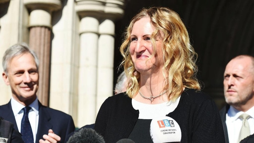 Claire Blackman,  the wife of convicted British Royal marine Alexander Blackman, speaks to the media outside the High Court in London Wednesday March 15, 2017.  Blackman who shot an injured Taliban fighter in Afghanistan has had his murder conviction downgraded Wednesday. The murder conviction of 42-year-old Sgt. Alexander Blackman has been quashed and replaced by a manslaughter conviction.  (Lauren Hurley/PA via AP)