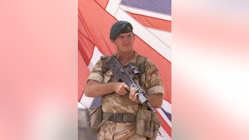 FILE - This is a Oct. 14, 2001 file photo of former Royal Marine Sergeant Alexander Blackman. Blackman who shot an injured Taliban fighter in Afghanistan has had his murder conviction downgraded Wednesday March 15, 2017. The murder conviction of 42-year-old Sgt. Alexander Blackman has been quashed and replaced by a manslaughter conviction.  (Andrew Parsons/file via AP)