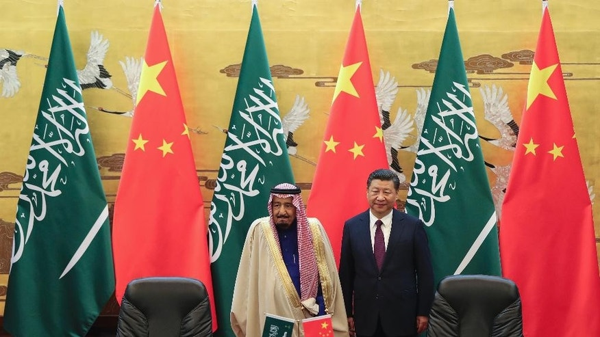 Saudi King Salman, left, and Chinese President Xi Jinping attend a signing ceremony at the Great Hall of the People in Beijing, China, Thursday, March 16, 2017. Salman began a visit to Beijing Thursday that highlights growing ties underpinned by China's thirst for Saudi oil and the kingdom's status as a key link in Beijing's bid to connect China to Europe through infrastructure development. (Lintao Zhang/Pool Photo via AP)