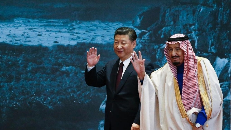 Saudi King Salman, right, and Chinese President Xi Jinping wave as they attend the Road to the Arab Republic - the closing ceremony of the artifacts unearthed in Saudi Arabia at China National Museum in Beijing, China, Thursday, March 16, 2017. (Lintao Zhang/Pool Photo via AP)