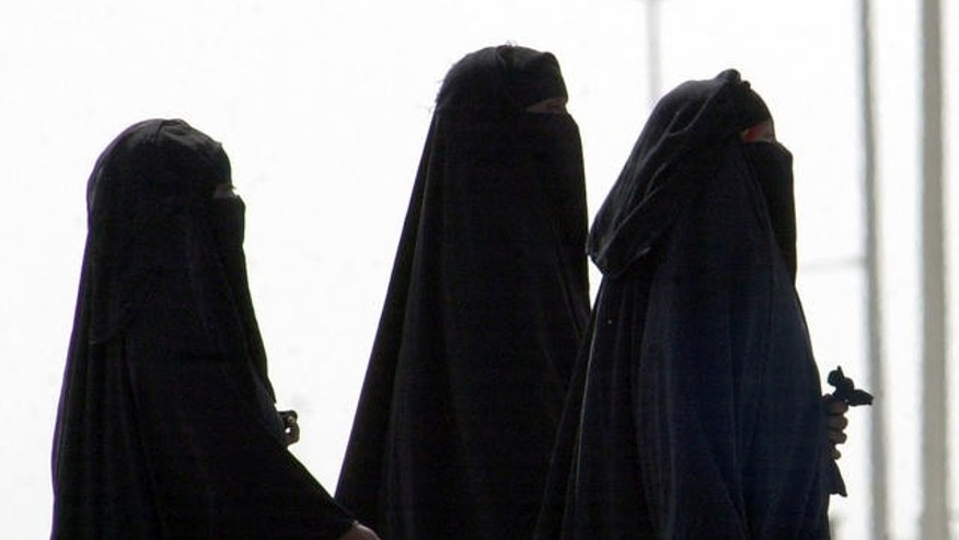 2006 FILE photo of unidentified Saudi women walking along a suburban street in Riyadh, Saudi Arabia.