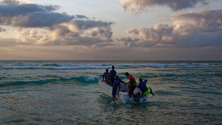 In this photo taken Tuesday, March 7, 2017, fishermen set out for their day's work in the Indian Ocean shortly after dawn in the former pirate village of Eyl, in Somalia's semiautonomous northeastern state of Puntland. The recent hijacking of an oil tanker has surprised the international shipping community, as many Somali pirates had quit and turned to fishing as anti-piracy patrols increased, but local officials have warned that rampant fishing by foreign trawlers is destroying the fishermen's livelihoods and stoking fears of a return of piracy as a way to make money. (AP Photo/Ben Curtis)