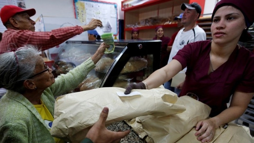 People buy bread at a state-run bakery in Caracas, Venezuela, June 25, 2016.
